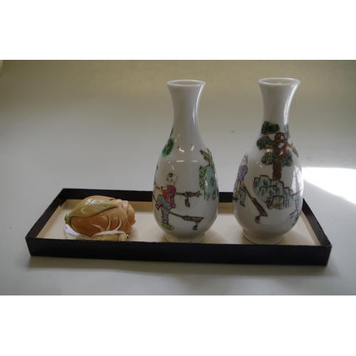 582 - <strong>A small pair of Chinese famille verte vases, </strong>10.5cm high; <strong>together with </s...