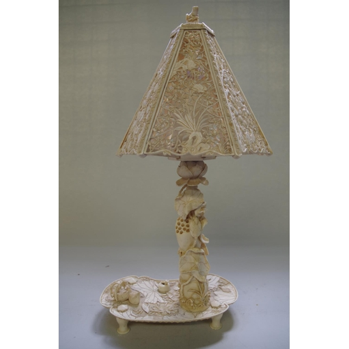 585 - <strong>A good Japanese carved ivory table lamp,</strong> <em>Meiji period,&nbsp;</em>of naturalisti...