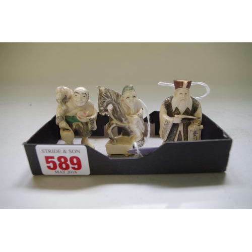 589 - <strong>Three Japanese carved ivory netsukes,</strong>&nbsp;each signed, largest 5cm high. (3)...