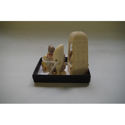 592 - <strong>Two Japanese ivory nesuke;</strong> together with an Indian ivory sedan chair figure group, ...