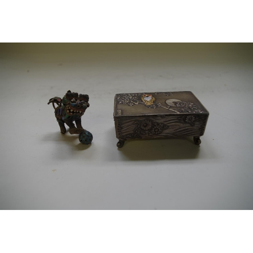 593 - <strong>A Japanese metal miniature casket,</strong> the hinged lid decorated with a gilt owl, 6.5cm ...
