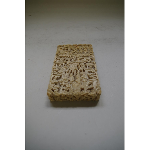 595 - <strong>A Chinese Canton ivory card case &amp; cover,</strong> <em>late 19th century, </em>9.5 x 5.5...