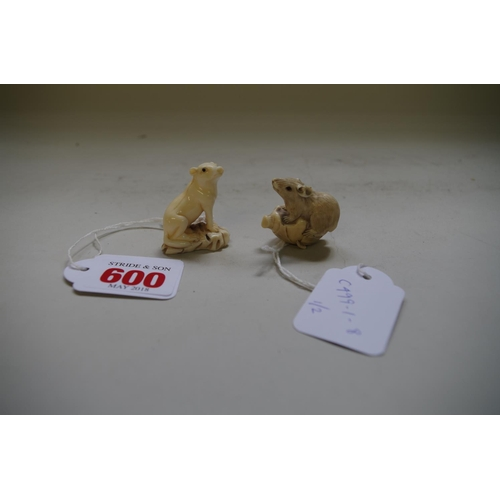 600 - <strong>Two Japanese carved ivory netsukes,</strong> one depicting a rat on a nut, 3.5cm high; the o...