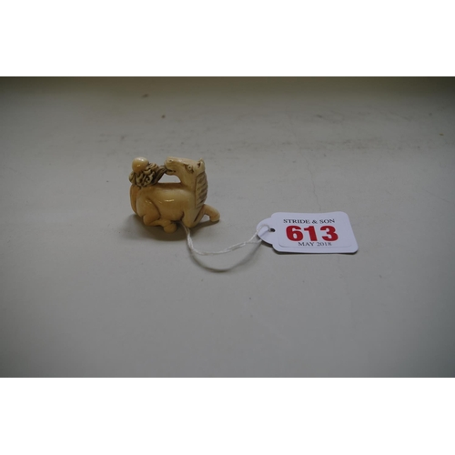 613 - <strong>A Japanese carved ivory netsuke of a horse,</strong> indistinctly signed, 4.6cm long....