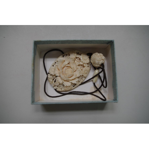 618 - <strong>A Chinese carved and pierced ivory floral pendant,</strong> 6.5 x 4.5cm...