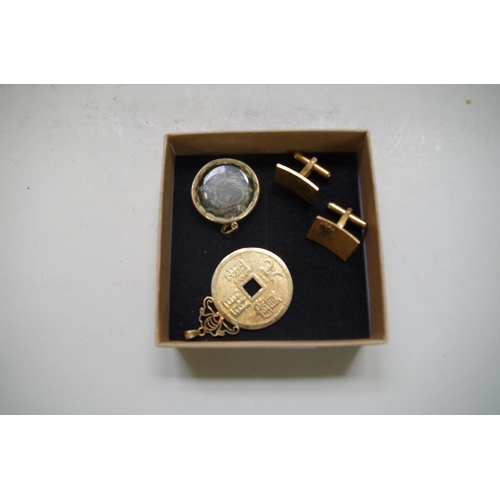 623 - <strong>A pair of Chinese 14k gold cufflinks,</strong> 7.6g; together with a gilt coin pendant; and ...