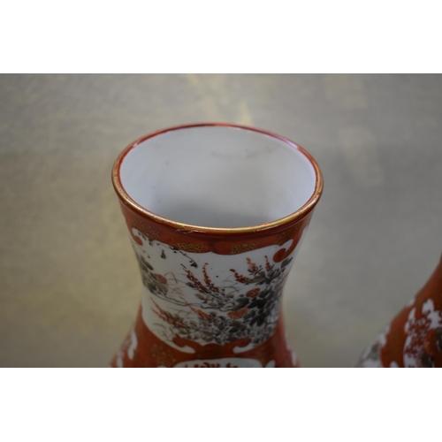 633 - <strong>A pair of Japanese Kutani vases,&nbsp;</strong><em>late 19th century,&nbsp;</em>33.5cm high....