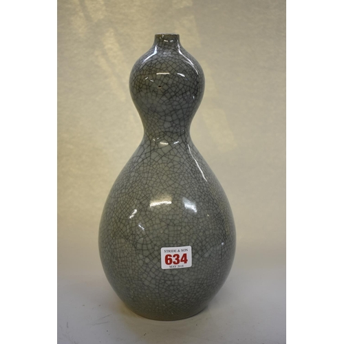 634 - <strong>A Chinese crackle glaze celadon double gourd vase</strong>, 31cm high....