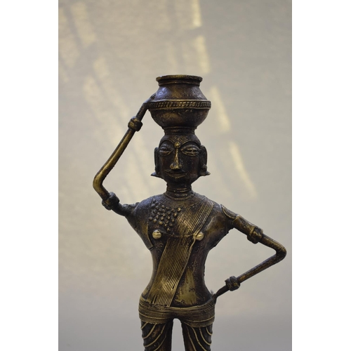 636 - <strong>An East Indian Dhokra bronze figure,</strong> <em>probably 19th century,</em> 26cm high....