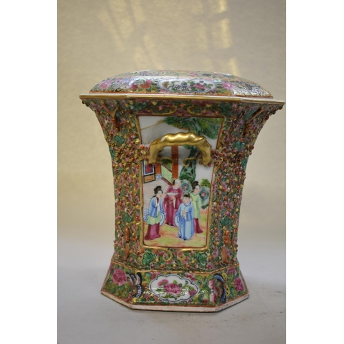 637 - <strong>A Chinese famille rose twin handled flower vase and pierced cover,</strong><em>late 19th ce...