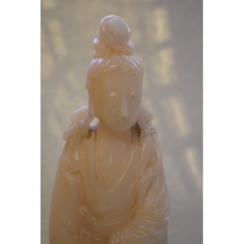 638 - <strong>A Chinese carved alabaster figure of Guanyin,&nbsp;</strong>32cm high, on fitted hardwood st...
