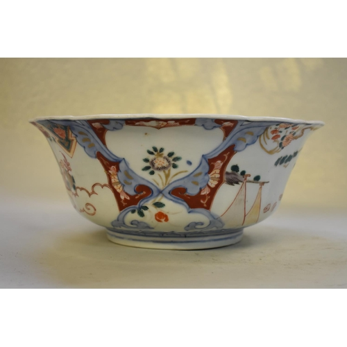 643 - <strong>A Chinese famille rose bowl, </strong><em>18th century, </em>25.5cm diameter, (stapled); tog...