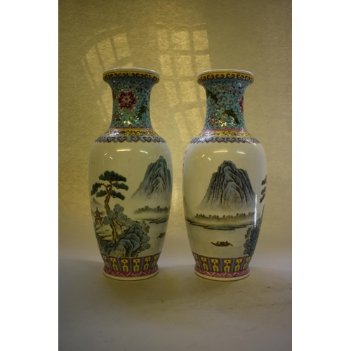 644 - <strong>A pair of Chinese famille rose vases,</strong>30.5cm high; together with another Chinese fa...
