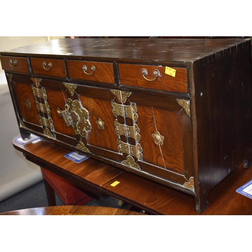 648 - <strong>An antique Korean elm and brass low cabinet,</strong> 88cm wide....