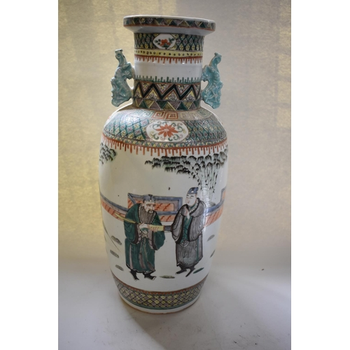 657 - <strong>A Chinese famille verte twin handled vase, </strong><em>19th century, </em>45cm high....