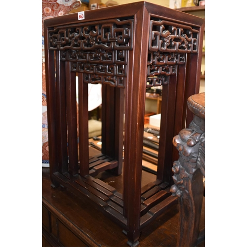 663 - <strong>A nest of four Chinese carved hardwood quartetto tables,</strong> labelled 'Hou Chang House,...