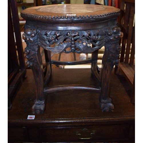 664 - <strong>A Chinese carved hardwood and marble inset jardiniere stand,</strong> 44.5cm wide....