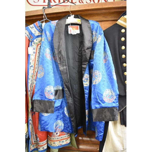 669 - <strong>A Chinese embroidered blue silk jacket.&nbsp;</strong>...
