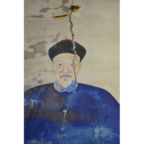 670 - <strong>Two similar Chinese ancestor portraits,</strong> <em>Qing</em>, the first depicting a Mandar...