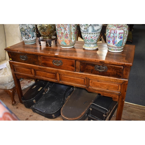 656 - <strong>An antique Chinese hardwood side table,</strong> with 3 frieze drawers, 149cm wide....