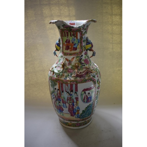 661 - <strong>A Chinese Canton famille rose twin handled vase, </strong>44.5cm high, (large rim chip)....