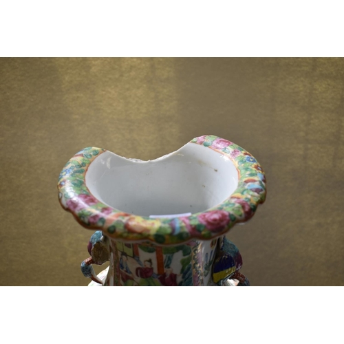 661 - <strong>A Chinese Canton famille rose twin handled vase,</strong>44.5cm high, (large rim chip)....
