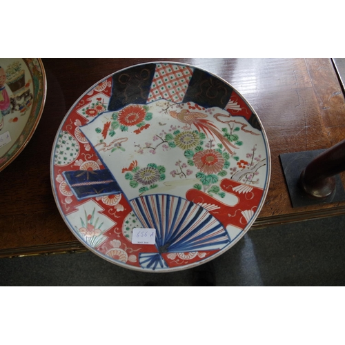 656A - <strong>A Chinese famille rose plate,</strong> 31cm diameter; together with another Japanese Imari p...