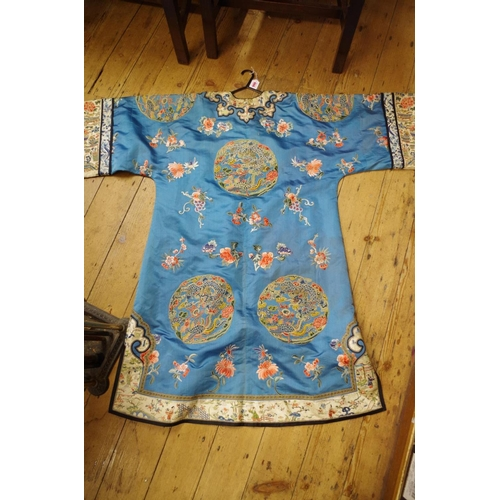 666 - <strong>A Chinese blue silk ladies jacket, </strong>embroidered with Peking Knot and decorated with ...