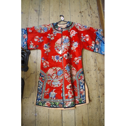667 - <strong>A rare Chinese red silk velvet robe,</strong> <em>probably 19th century,</em>embroidered wi...