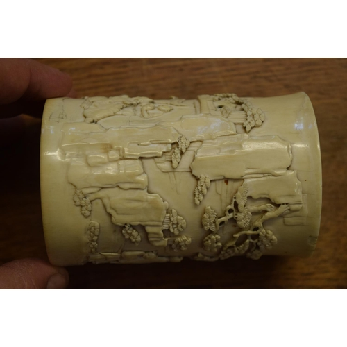 550 - <strong>A Chinese carved ivory brush pot <em>bitong, </em></strong><em>Qing, </em>carved in relief w...