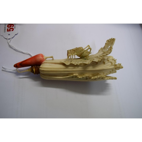 590 - <strong>A Chinese carved and stained ivory grasshopper on cabbage,</strong> 23.3cm long....