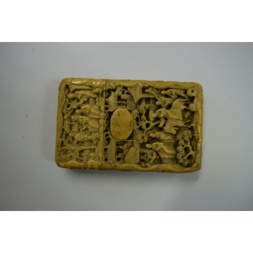 591 - <strong>A Chinese Canton carved ivory card case and cover,</strong> <em>late 19th century, </em>9.5 ...