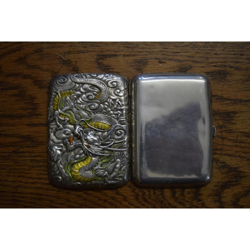 596 - <strong>A Chinese silver and enamel cigarette case,</strong> the hinged cover decorated in relief wi...