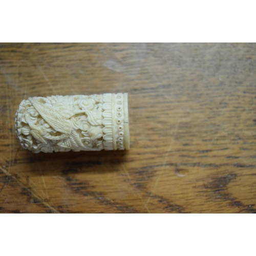 603 - <strong>A Chinese carved ivory needle case and cover</strong>,<em>late 19th century,</em>15cm long...