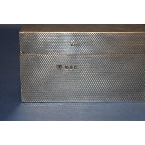 1 - A silver rectangular engine turned cigarette box, by C J Vander,London 1963, 18cm x 9cm, 540g all i...
