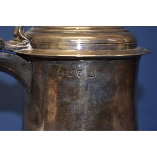 16 - A Georgian silver lidded beer tankard,having metal replacement base, 20cm.