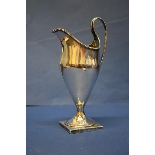17 - A Georgian silver helmet milk jug,by Charles Chesterman ll,London 1786, 17.5cm, 128g....