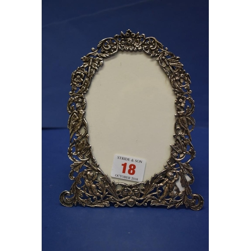 18 - A Victorian pierced silver photograph frame,by Henry Mansell,London 1889, decorated gree...