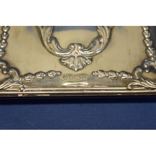 19 - A silver double photograph and clock frame,by Carr's of Sheffield Ltd,Sheffield 1996, 12cm x 18.5...