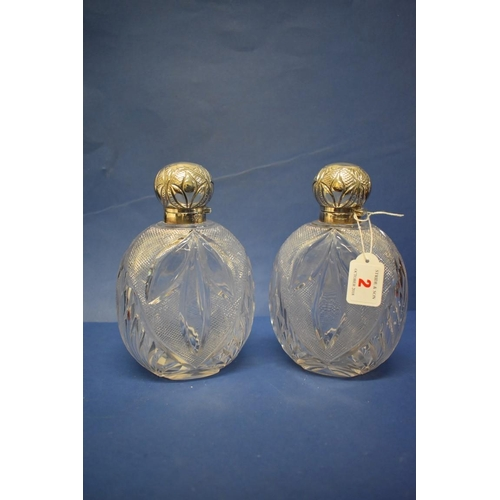 2 - A pair of late Victorian silver mounted cut glass perfume flasks,by James Dixon & Sons Ltd...