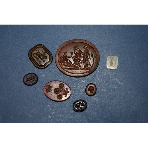 200 - <strong>Seven antique intaglio seals, </strong>various sizes and materials....