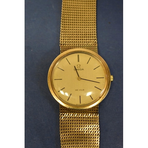 203 - <strong>A 9ct gold Omega Deville gentleman's wristwatch,</strong>on a 9ct gold mesh bracelet, 43.4g...