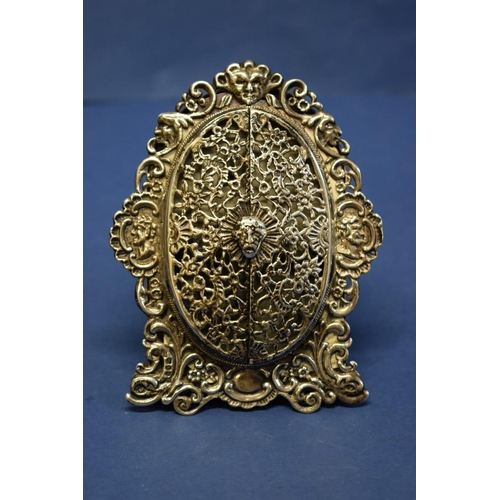 21 - A Victorian pierced silver photograph frame,by Rosenthal, Jacob & Co,London 1883, having centr...