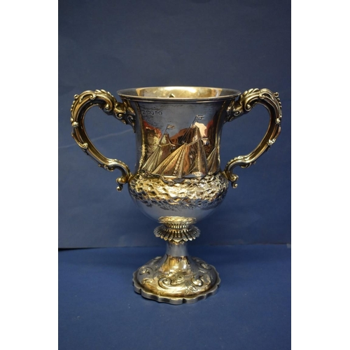 26 - A Victorian silver twin handled trophy cup, by A.B Savory & Sons, London 1861, decorated three y...