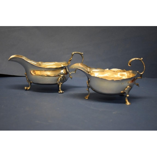 30 - A George lll silver sauce boat,London 1762; together with a similar example, by Peter Guille Ltd,L...
