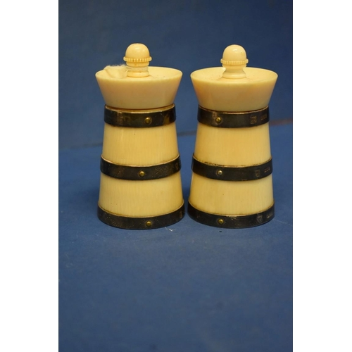 31 - <strong>A pair of Victorian silver banded ivory capstan pepper mills,</strong><em>by</em> <em>Golds...