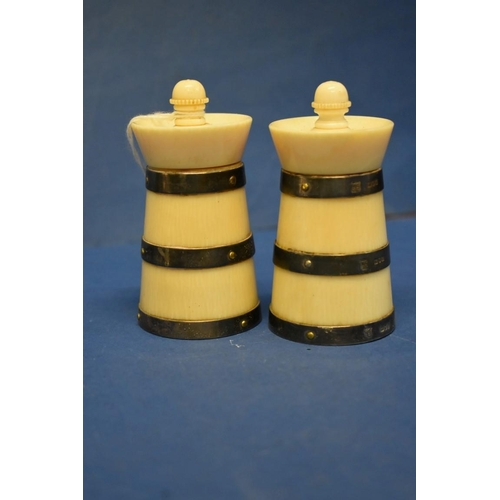31 - A pair of Victorian silver banded ivory capstan pepper mills,by Goldsmiths & Silversmiths,Lond...