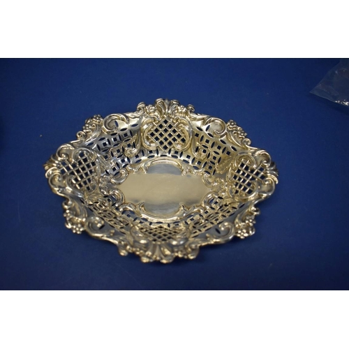 41 - A hammered silver bowl,by Barker Bros,Chester 1913; together with a pierced silver dish;...