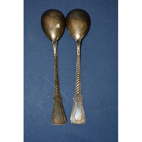 48 - A pair of Soviet Union silver and enamel spoons, by Tallinnskaja Juvelirnaja Fabrika, Tallinn 1967....