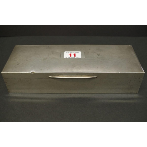 11 - <strong>An engine turned rectangular silver cigarette box,</strong><em> by E &amp; N Speak</em>, Bir...